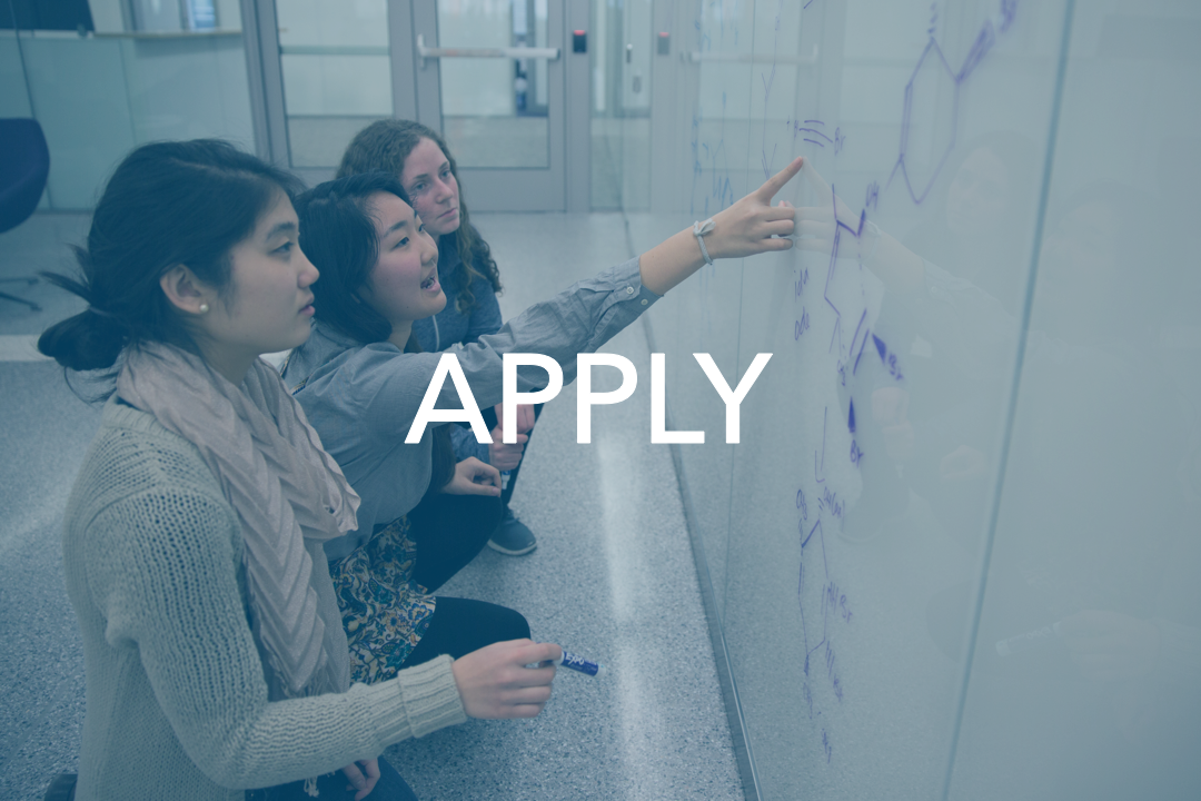 Apply; three students working at white board