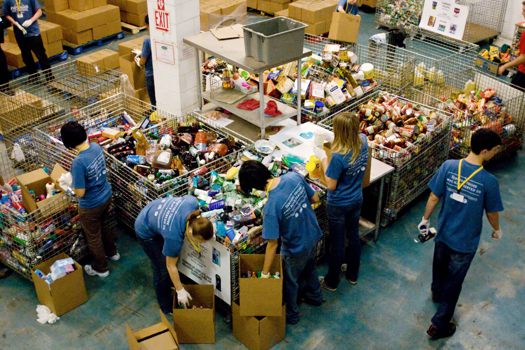 Students volunteering in food warehouse