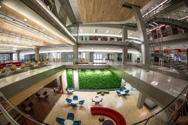 Interior view of Science & Engineering Hall including green wall, study areas, meeting spaces, classrooms and labs