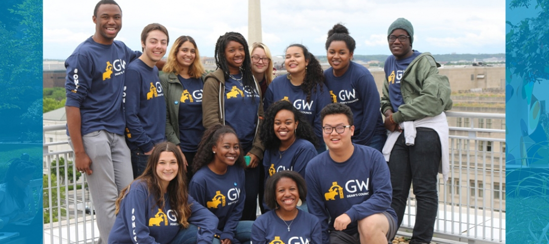 Dean's Council members smiling with Washington Monument in the background