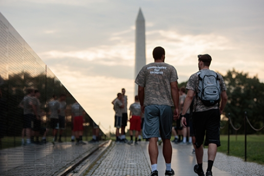 students walking on National Mall at Vietnam Memorial towards Washington Monument